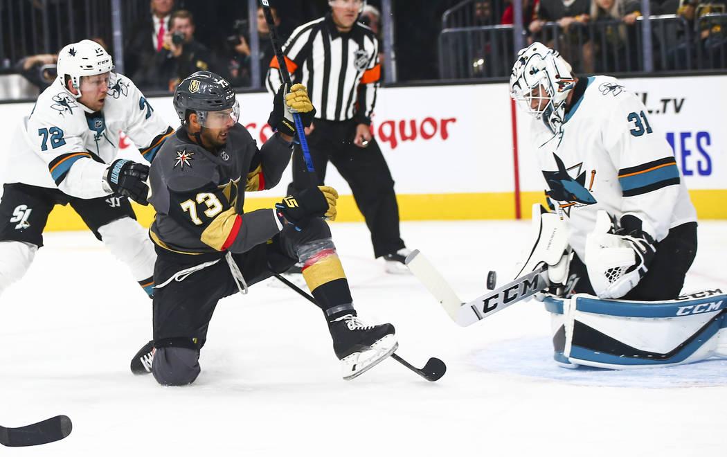 San Jose Sharks goaltender Martin Jones (31) blocks a shot from Golden Knights' Brandon Pirri ( ...
