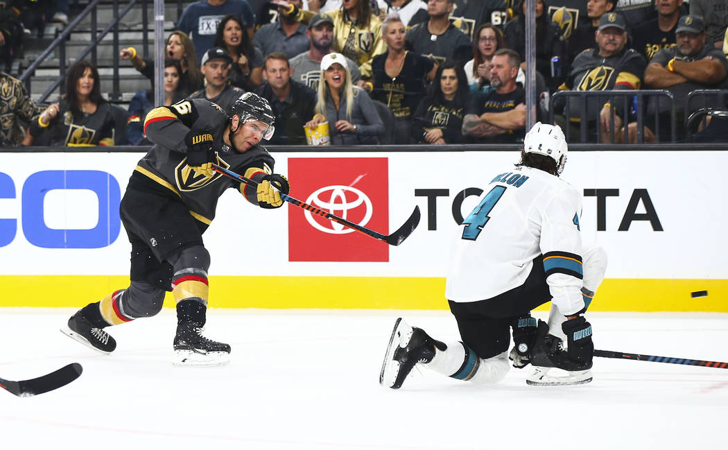 Golden Knights' Paul Stastny (26) shoots past San Jose Sharks' Brenden Dillon (4) during the fi ...