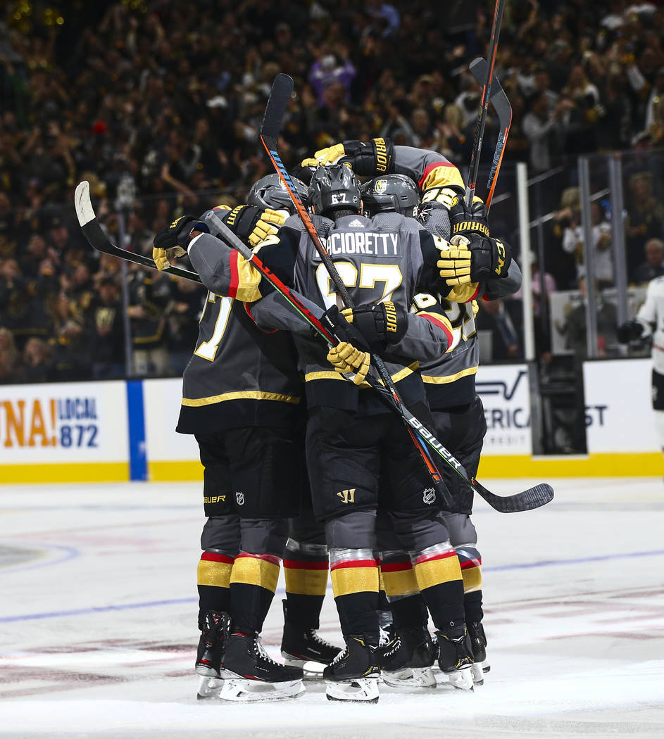 Golden Knights players celebrate after a goal by Mark Stone during the first period of their NH ...