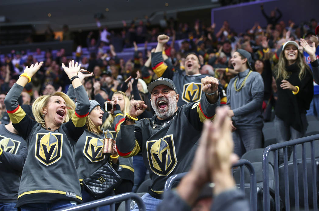 Golden Knights fans celebrate a goal by Cody Glass during the second period of their NHL season ...