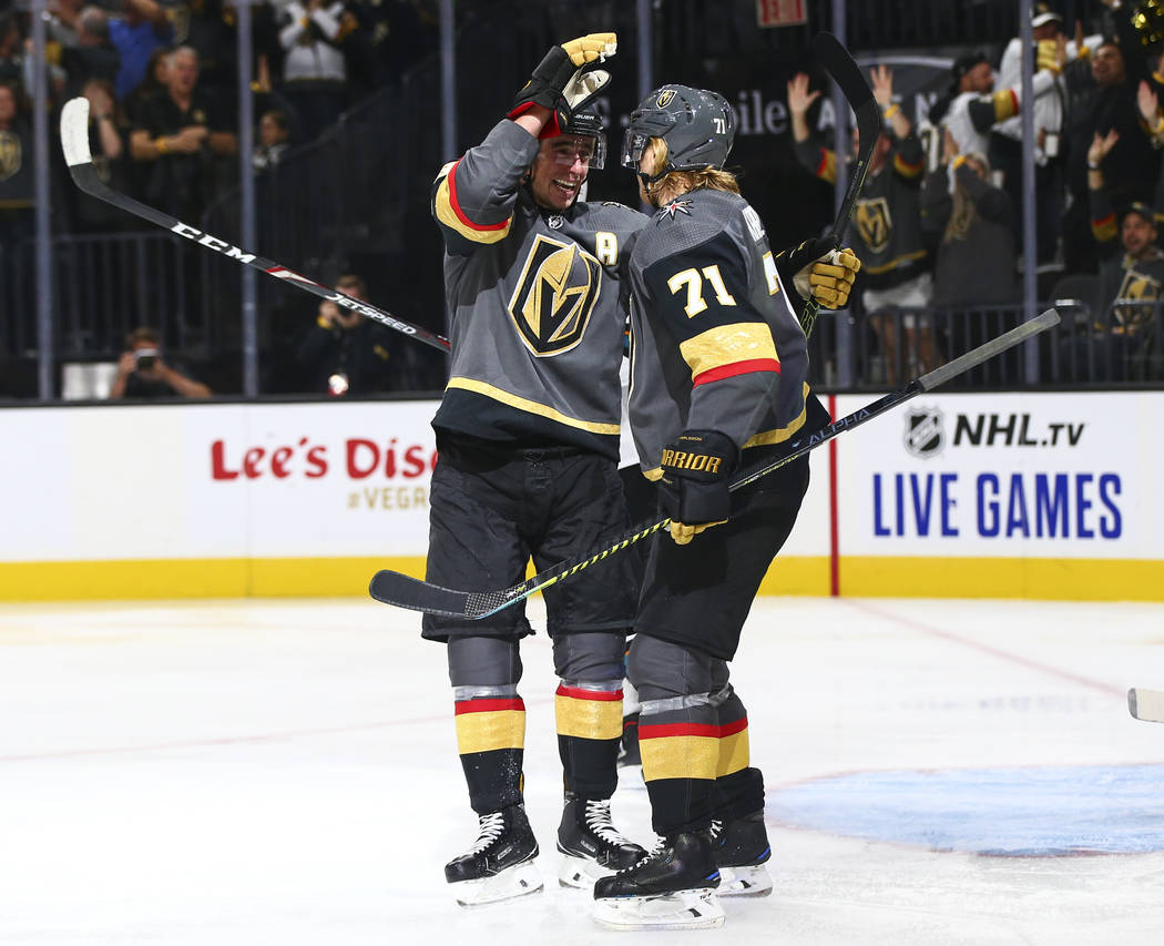 Golden Knights' Reilly Smith, left, and William Karlsson (71) celebrate a shorthanded goal agai ...