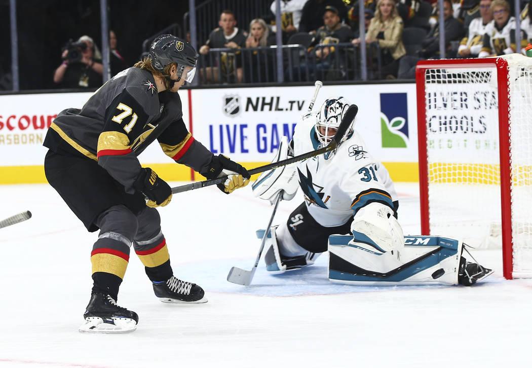 San Jose Sharks goaltender Martin Jones (31) blocks a shot from Golden Knights' William Karlsso ...