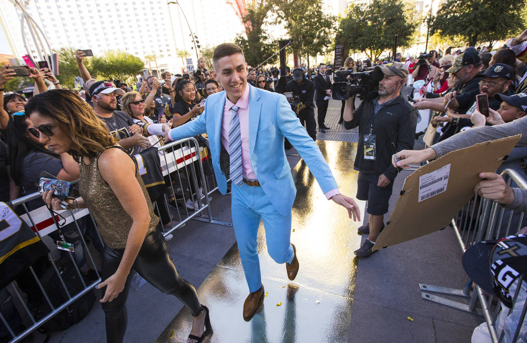 Golden Knights' Tomas Nosek arrives at the gold carpet for the NHL season-opening hockey game a ...