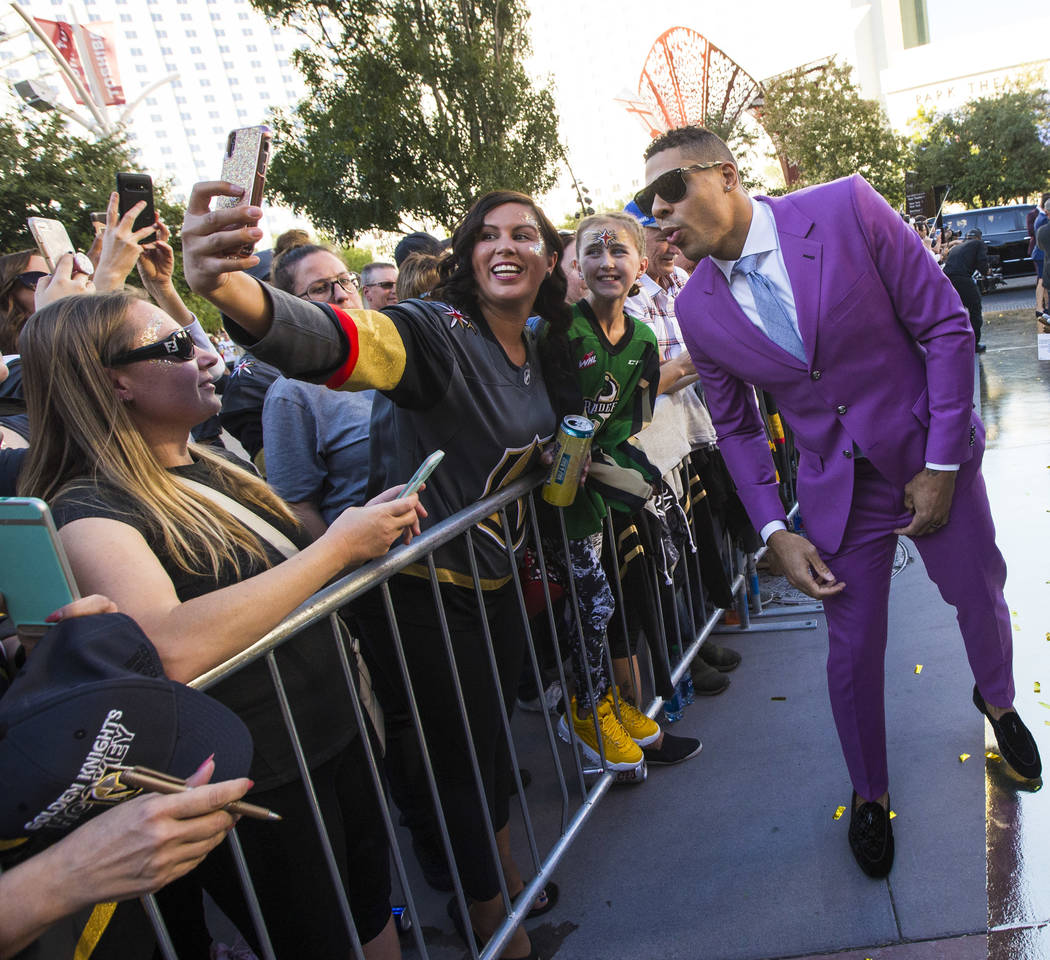 Golden Knights' Ryan Reaves poses for a photo with fans on the gold carpet after arriving for t ...