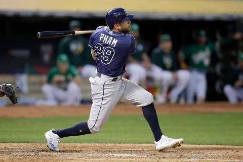 Tampa Bay Rays' Tommy Pham (29) hits a solo home run against the Oakland Athletics during the f ...