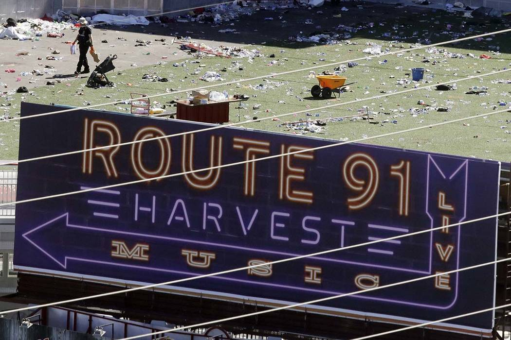 Investigators work the scene after a mass shooting at a music festival near Mandalay Bay on the ...