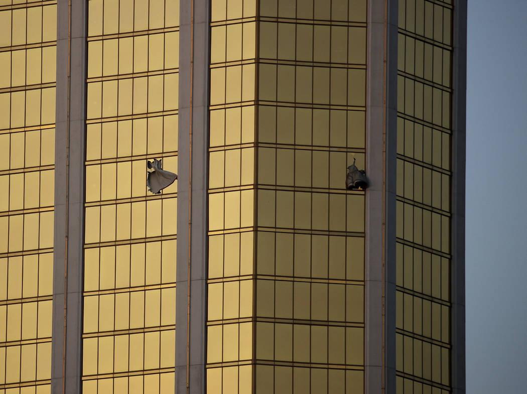 Drapes billow out of broken windows at Mandalay Bay on the Las Vegas Strip on Oct. 2, 2017, fol ...