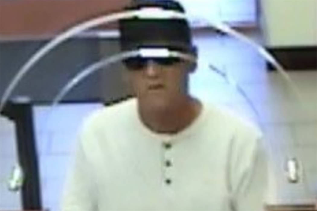 Police are searching for a man suspected of robbing a branch of Nevada State Bank in downtown L ...
