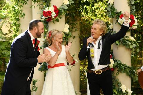 Rock legend Rod Stewart is shown with Sharon Cook and Andrew Aitchison at the couple's wedding ...