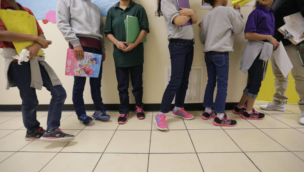 "Migrant teens line up for a class at a ""tender-age"" facility for babies, children and ..."