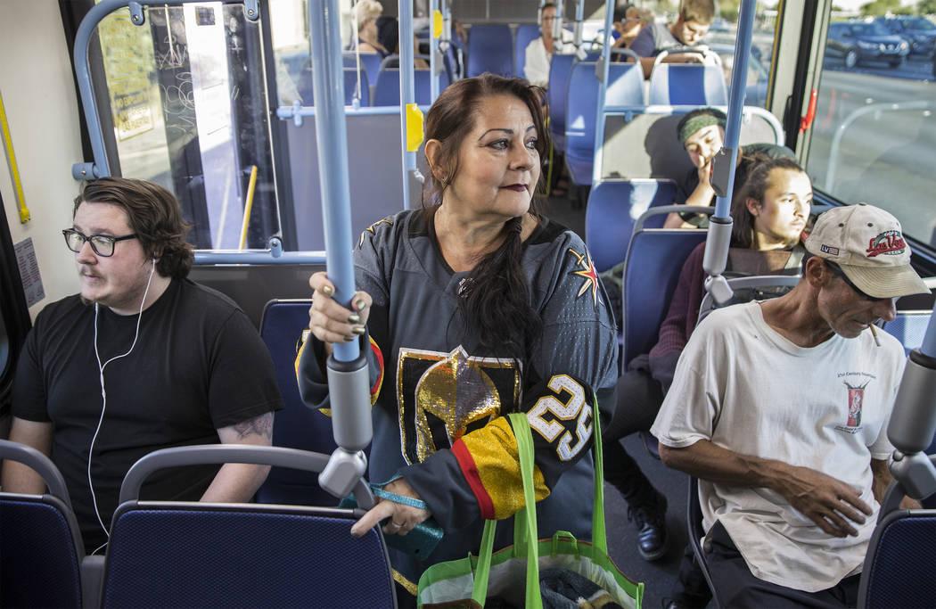 Elena Leger rides an RTC bus to Toshiba Plaza to watch the Vegas Golden Knights season opener a ...