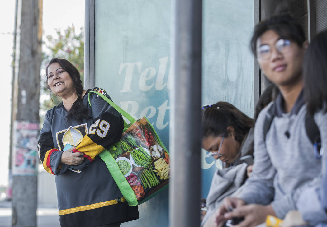 Elena Leger, left, waits for an RTC bus to take her to Toshiba Plaza to watch the Vegas Golden ...