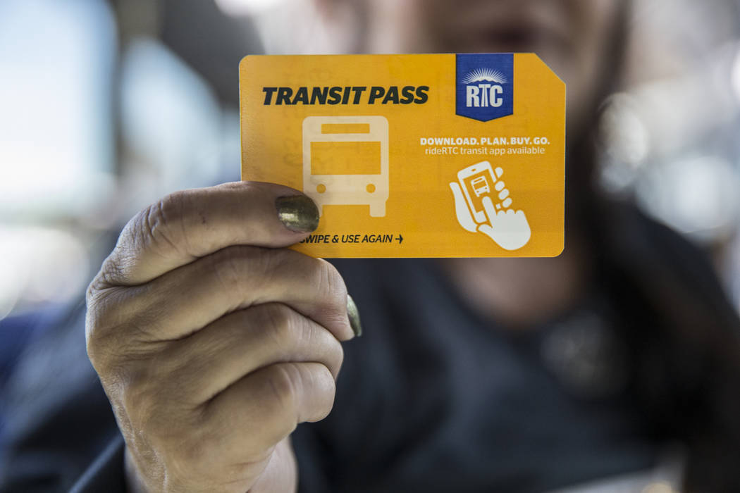 Elena Leger holds her one-day RTC bus pass while en route to Toshiba Plaza to watch the Vegas G ...
