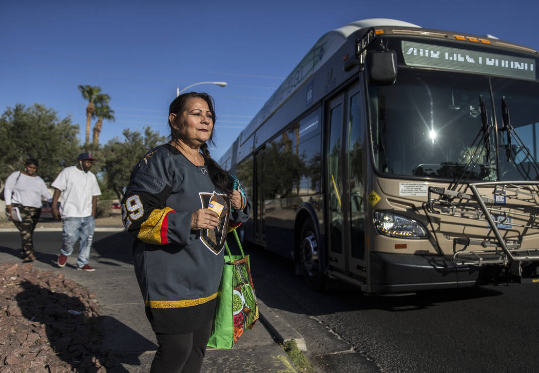 Elena Leger waits to board an RTC bus on East Tropicana Avenue to watch the Vegas Golden Knight ...