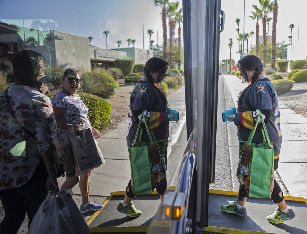 Elena Leger, right, boards an RTC bus on East Tropicana Avenue to watch the Vegas Golden Knight ...