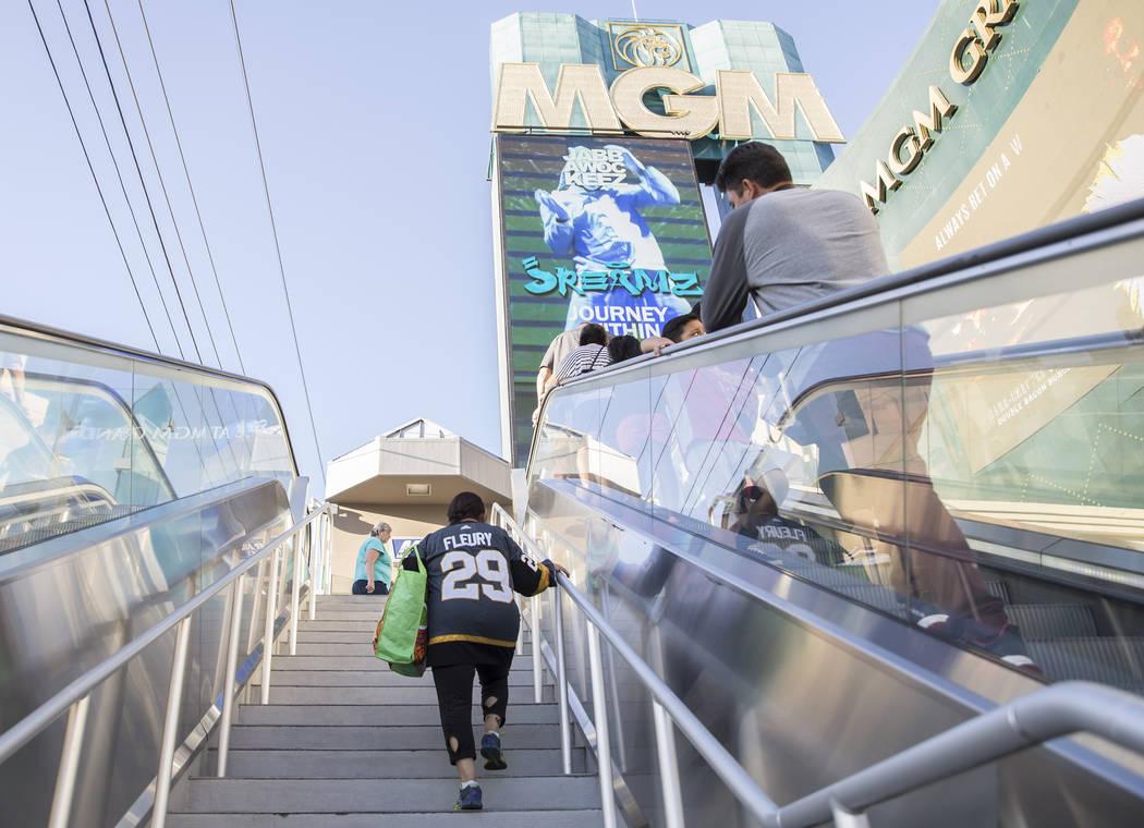 Elena Leger, left, walks towards Toshiba Plaza to watch the Vegas Golden Knights season opener ...