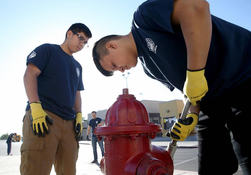 Bonanza High School Fire Science Academy junior Gerardo Bucio, left, and Edgar Linares prepare ...