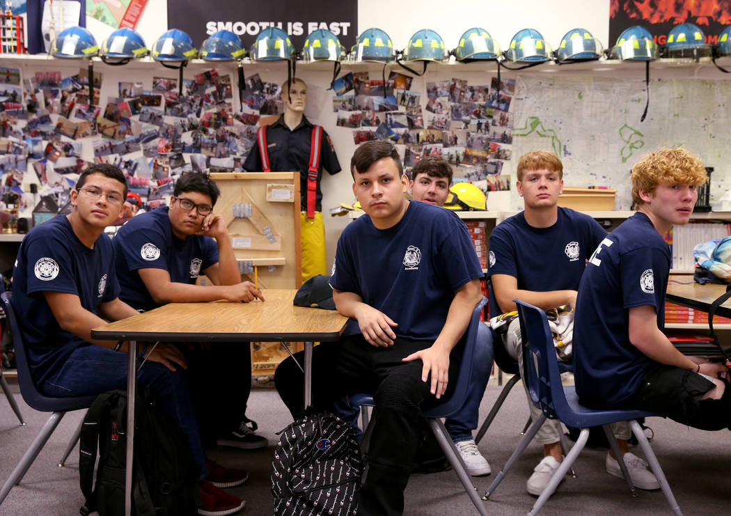 Bonanza High School Fire Science Academy students, from left, junior Christopher Ortega, senior ...