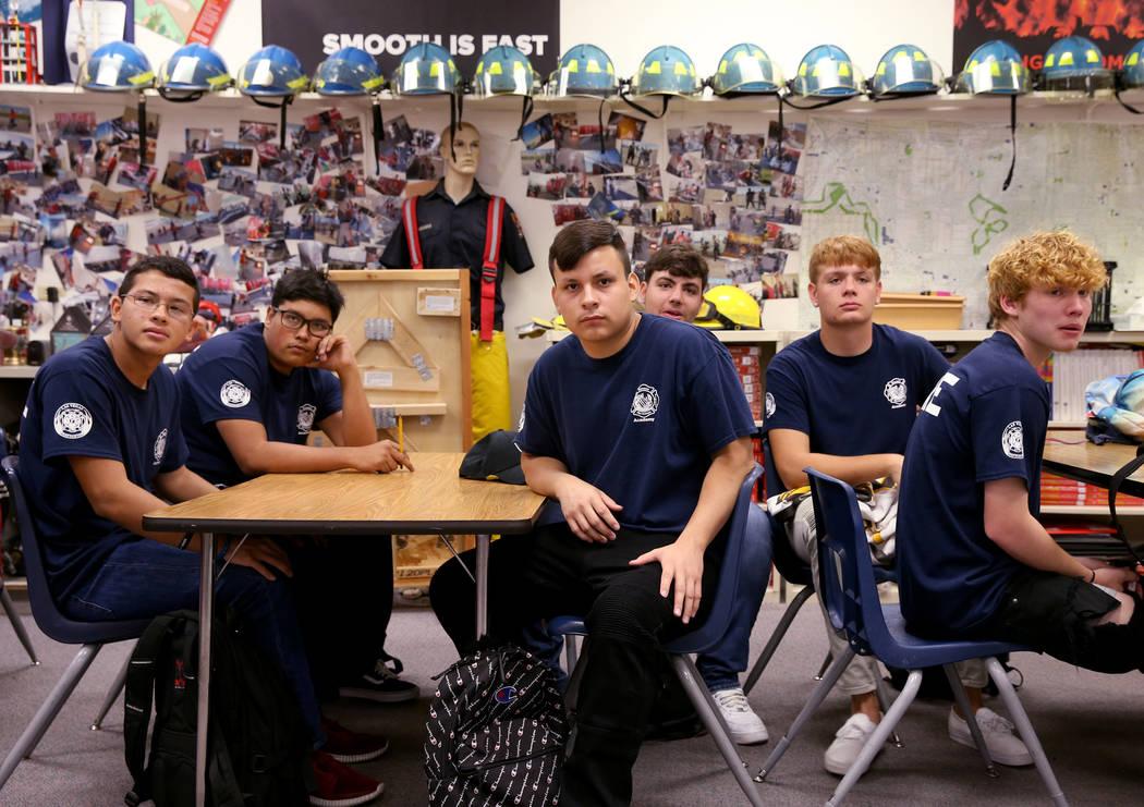Bonanza High School Fire Science Academy students, from left, junior Christopher Ortega, senior ...