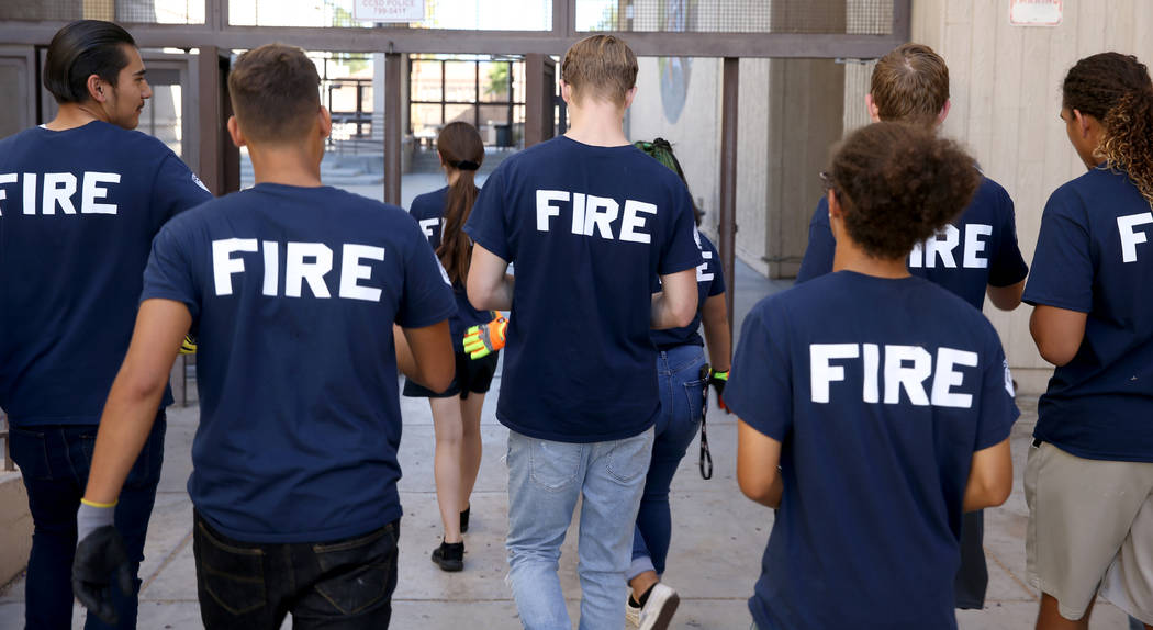 Bonanza High School Fire Science Academy students return to class after fire certification at t ...