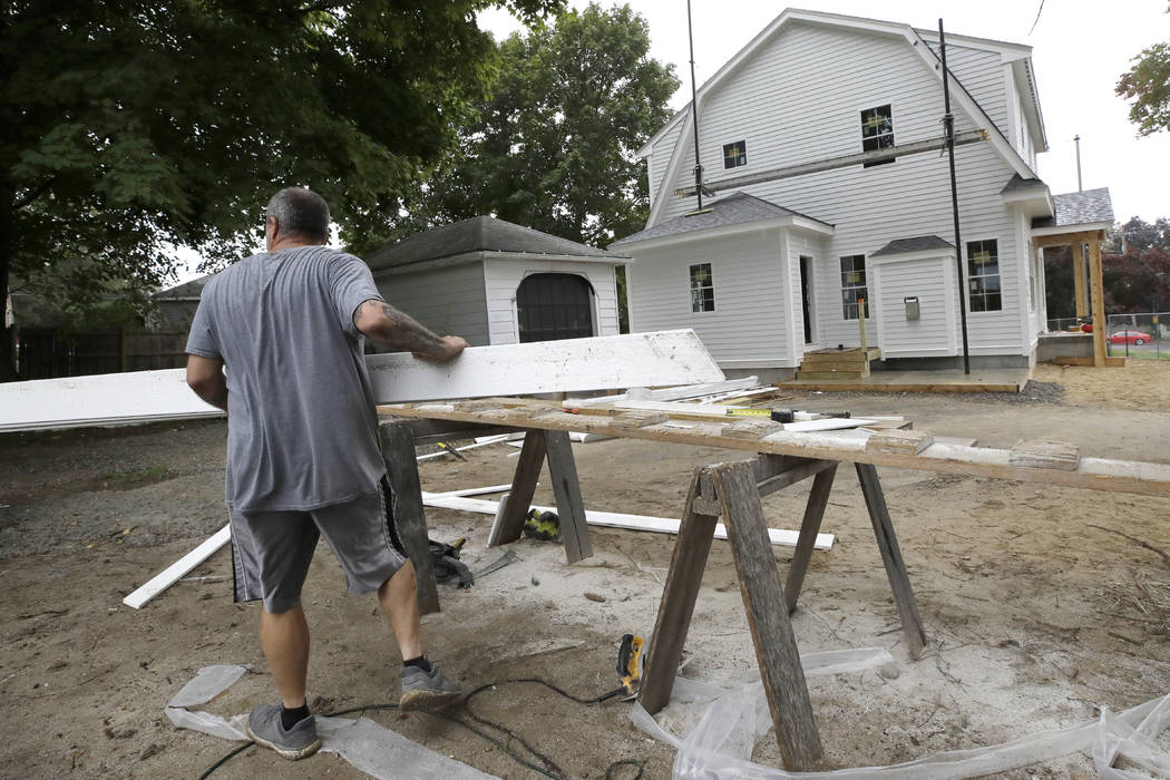 In this Wednesday, Oct. 2, 2019, photo, a carpenter works on a construction site in North Andov ...