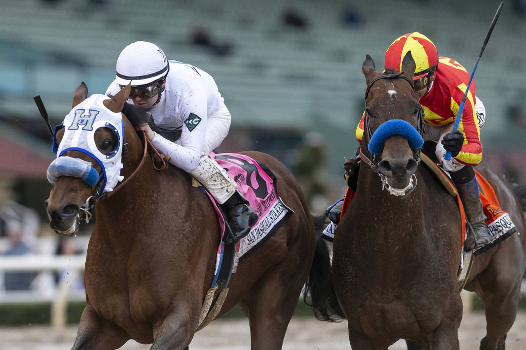 In a photo provided by Benoit Photo, Battle of Midway and jockey Flavien Prat, left, outleg McK ...