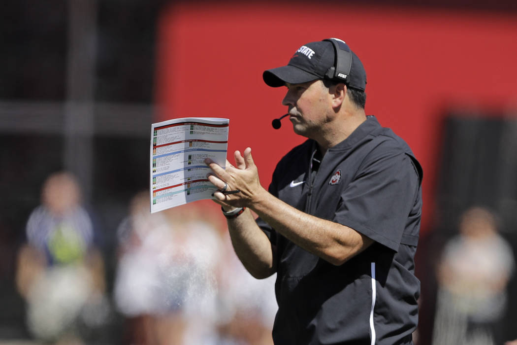 Ohio State head coach Ryan Day reacts after a touchdown during the first half of an NCAA colleg ...