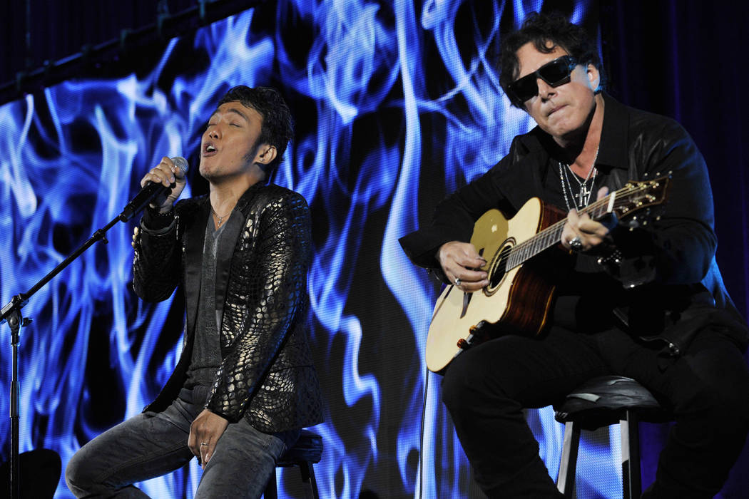 In this Aug. 6, 2013 file photo, Arnel Pineda, left, and Neal Schon of the rock band Journey pe ...