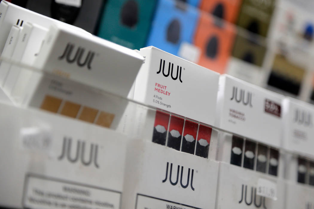 In a Dec. 20, 2018, file photo, Juul products are displayed at a smoke shop in New York. On Thu ...
