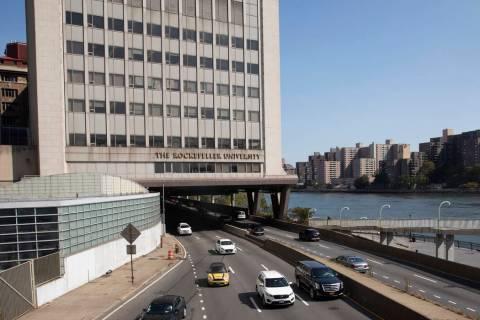 In a Sept. 26, 2019, photo, cars pass Rockefeller University in New York. Prestigious universit ...