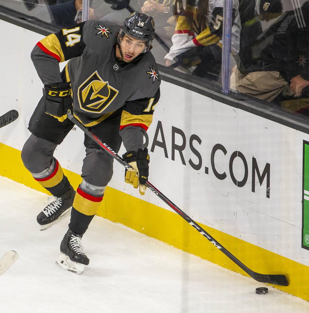 Vegas Golden Knights defenseman Nicolas Hague (14) looks to pass versus the San Jose Sharks dur ...