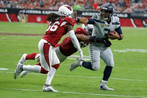 Seattle Seahawks quarterback Russell Wilson (3) during an NFL football game against the Arizona ...