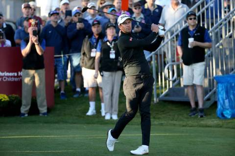 Adam Scott watches his tee shot on the 10th hole during Shriners Hospitals for Children Open at ...