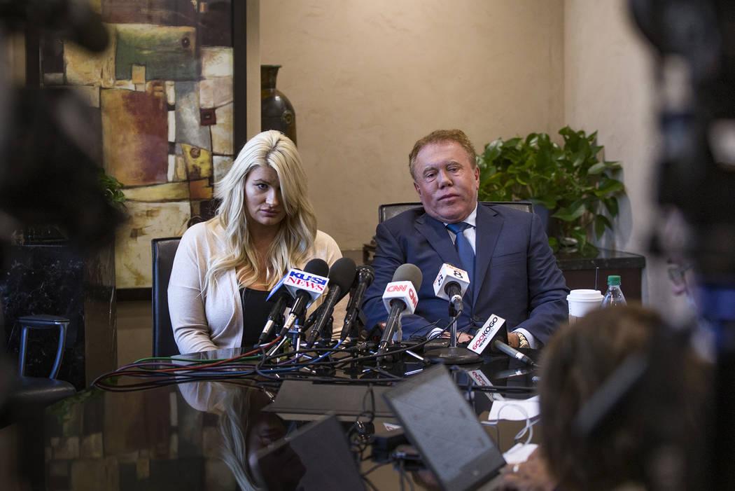 Chelsea Romo, a survivor of the Route 91 mass shooting, left, addresses the media next to Attor ...