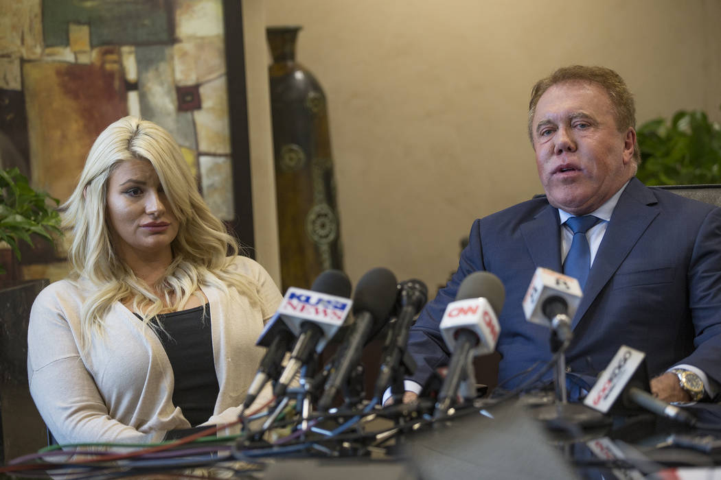 Chelsea Romo, a survivor of the mass shooting in Las Vegas, left, addresses the media with atto ...