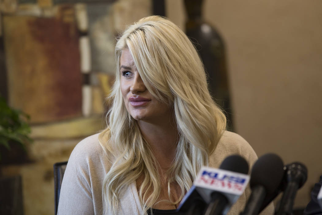 Chelsea Romo, a survivor of the mass shooting in Las Vegas, talks to the media at a news confer ...