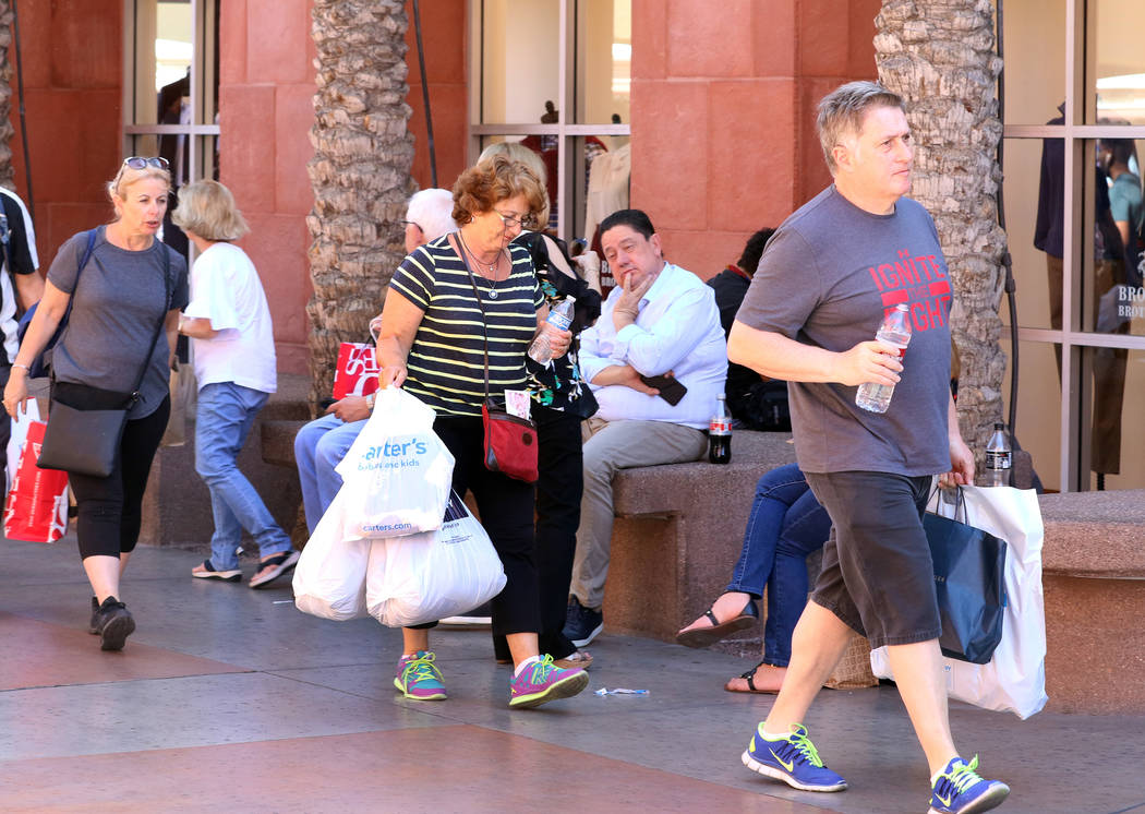Shoppers walk through Las Vegas North Premium Outlets on Tuesday, Sept. 17, 2019. The outlet ma ...