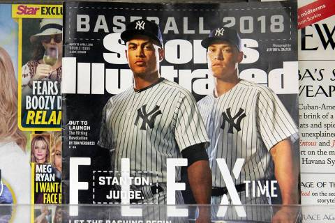 An issue of Sports Illustrated is displayed on a newsstand, Tuesday, May 28, 2019 in New York. ...