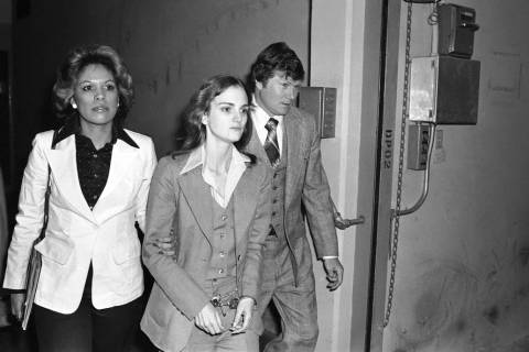 FILE - In this April 12, 1976 file photo, accompanied by deputy U.S. Marshal John Brophy, Patty ...