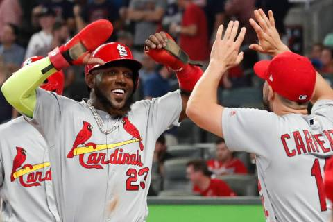 St. Louis Cardinals' Marcell Ozuna (23) celebrates his two-run double against the Atlanta Brave ...