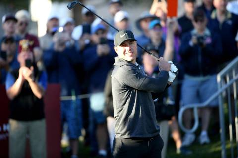 Brooks Koepka watches his tee shot on the 10th hole during Shriners Hospitals for Children Open ...