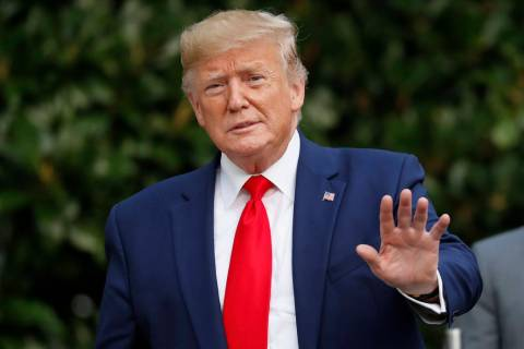 President Donald Trump gestures towards members of the media on the South Lawn of the White Hou ...