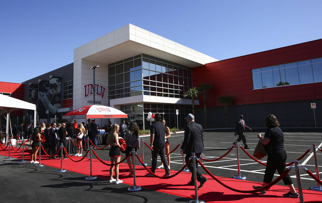 Attendees arrive for a ribbon cutting ceremony for the Fertitta Football Complex at UNLV in Las ...