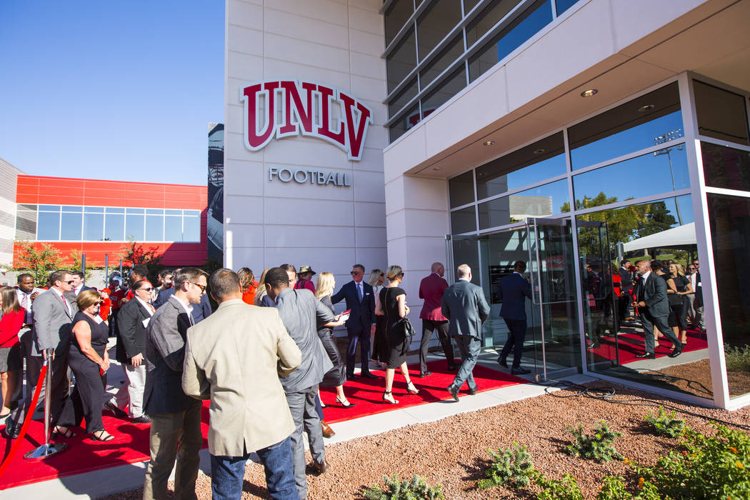 Attendees tour the Fertitta Football Complex following a ribbon cutting ceremony at UNLV in Las ...