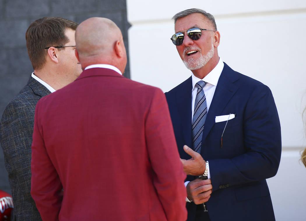 Frank Fertitta III, right, talks with UNLV football coach Tony Sanchez before the start of a ri ...