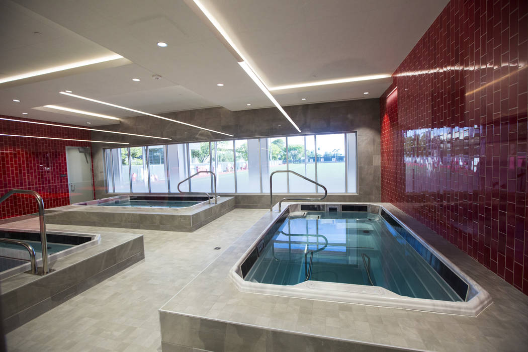 Hydrotherapy pools are seen during a tour of the Fertitta Football Complex following the ribbon ...