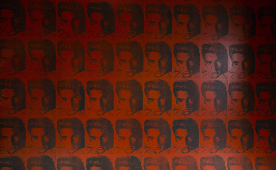 Wallpaper depicting Elvis Presley at the players club lounge area during a tour of the Fertitta ...
