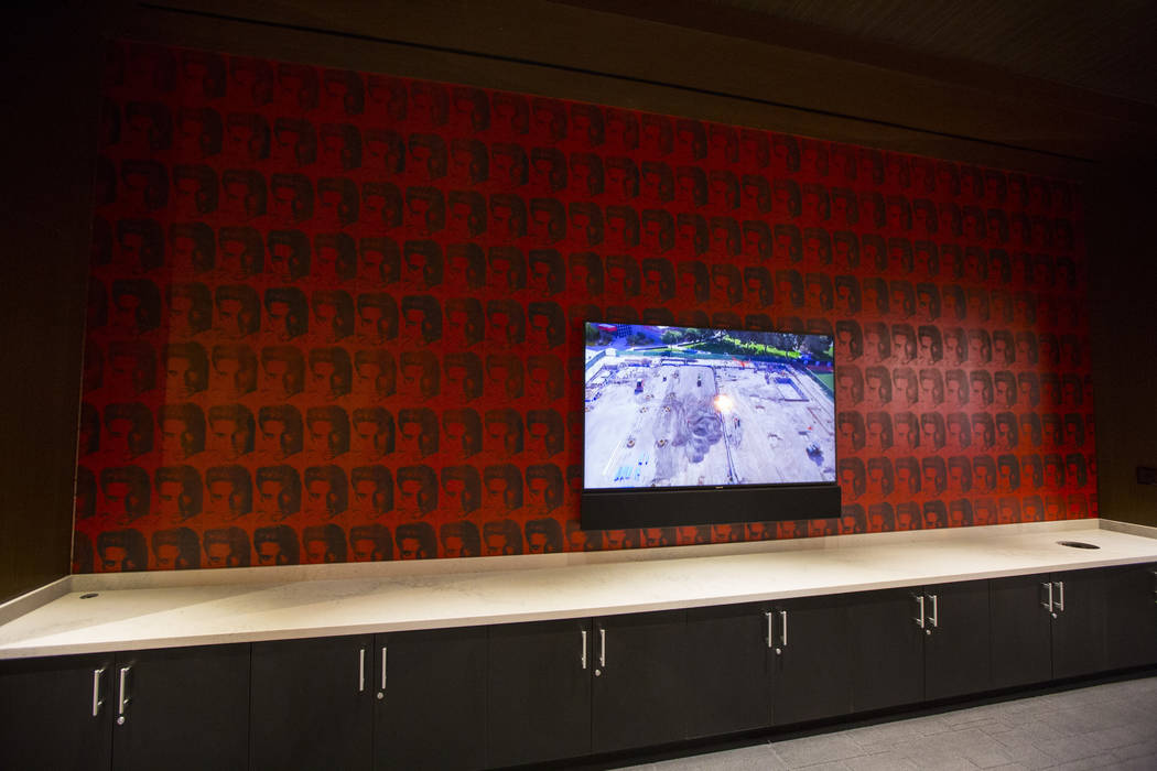 A TV in the players club lounge area is seen during a tour of the Fertitta Football Complex fol ...