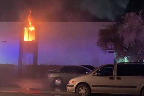 Flames are seen from a second-story apartment at 4264 Silver Dollar Ave. in central Las Vegas e ...
