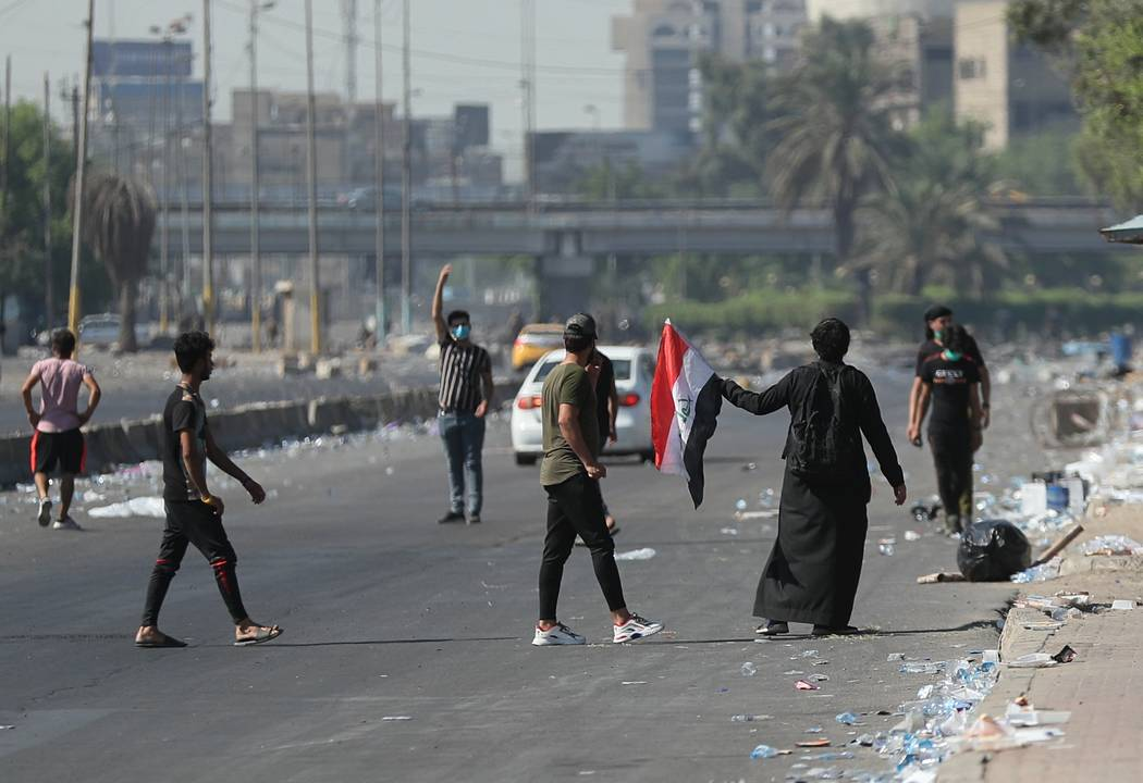 Anti-government protesters gather for a demonstration in Baghdad, Iraq, Friday, Oct. 4, 2019. I ...